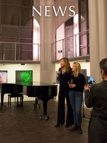 News page link. Image: Laura Meddens addresses the gathering of people at the Opening Night Reception of her Solo Exhibition at the Amstelkerk in Amsterdam.