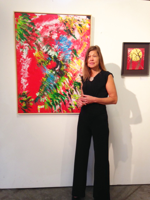 Laura Meddens with her painting 'Tropical Splash' in the main exhibition hall at Open Ateliers Oost in Amsterdam.