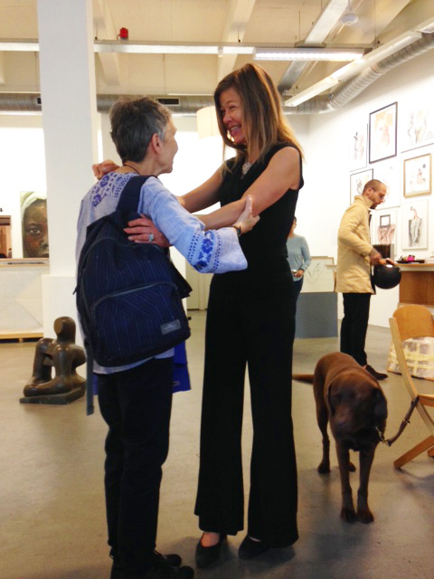 Laura Meddens greets her friend Mauricia at the Open Ateliers Oost exhibition in Amsterdam.