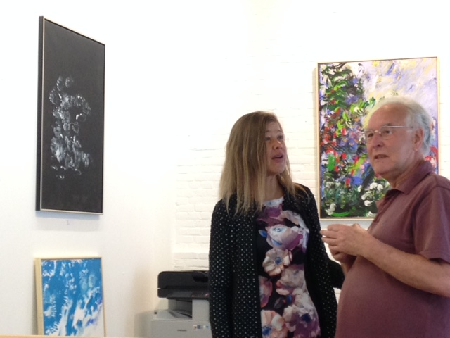 Laura Meddens speaking with Stan Polman, the Founder and publisher of oost-online.nl as he comments on her paintings at Open Ateliers Oost in Amsterdam.