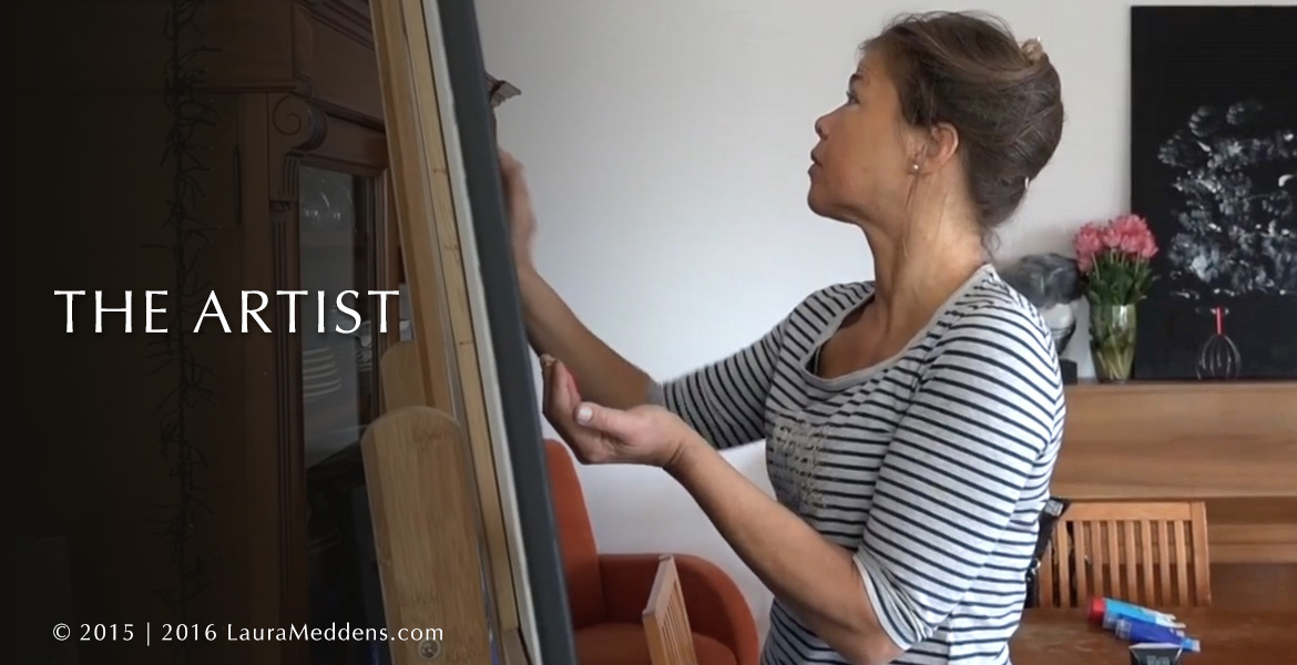 The Artist Page Banner. A photo shows a left-side view of Laura Meddens painting at an easel. Some pink flowers and her painting 'Tango' can be seen on top of an upright piano in the background.