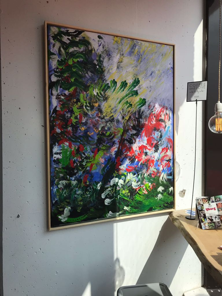 A photo of Laura Meddens' painting Botanical Surge on display at Stijldepartment.