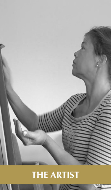 The Artist. Image: Photo of Laura working on a painting on her easel.