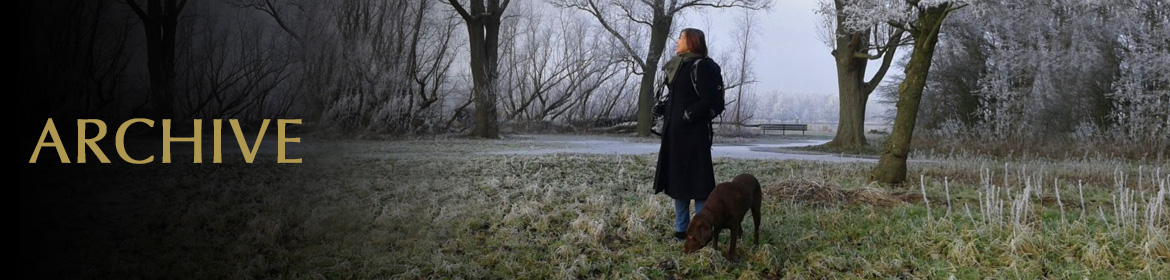 Archive Page. Image: Laura Meddens stands with her dog Nugget in a frosty landscape.