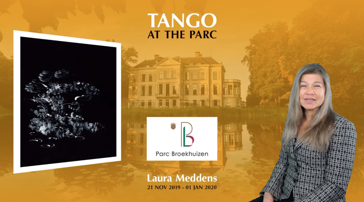 "Video frame shows Laura Meddens and her painting ""Tango"" against a large photo background of Parc Broekhuizen in Leersum, for her exhibition from the 21st of November 2019 to the first of January, 2020."